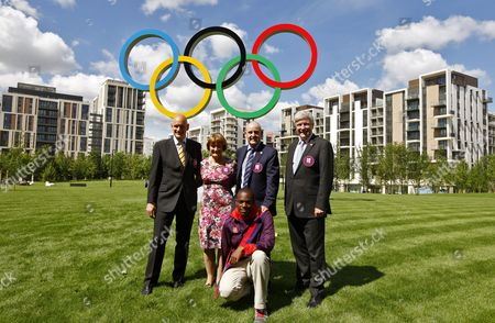 Olympic Gold Medallist Duncan Goodhew (l) Shadow Cabinet Minister Tessa Jowell (2nd L) Olympic Village Mayor Charles Allen (2nd R) Chair of the Cultural Olympiad Tony Hall (r) and a Youth Mayor Ozzie Clarke-binns (front) Pose For Media in Front of Giant Olympic Rings at Victory Square of the Olympic Village of the London 2012 Olympic Games in London Britain 12 July 2012 London Will Be Host For the 2012 Olympic Games Which Will Take Place From 27 July to 12 August 2012 and the Paralympic Games From 29 August to 09 September 2012 United Kingdom London