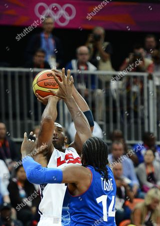 United States' Kobe Bryant (l) Takes a Shot Against France's Ronny Turiaf in the Second Half at Olympic Park During the London 2012 Olympic Games Basketball Competition in London Britain 29 July 2012 United Kingdom London