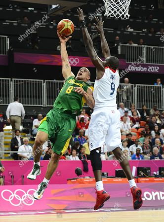 Great Britain Player Luol Deng (r) Tries to Block a Shot Against Brazil Player Alex Garcia (l) in the First Half of Their Game at the London 2012 Olympic Games in London Great Britain 31 July 2012 United Kingdom London