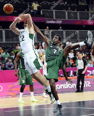 Lithuania's Antanas Kavaliauskas (l) Gets Fouled by Nigeria's Al-farouq Aminu in the Second Half of the Basketball Game at the London 2012 Olympic Games in London Great Britain 31 July 2012 United Kingdom London