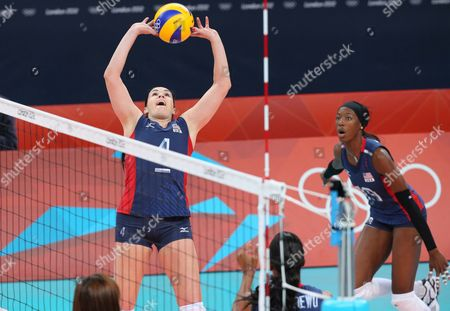 Usa Women's Volleyball Team Member Lindsey Berg (top) Hits a High Ball During in the London 2012 Olympic Games Pool a Women's Preliminary Round Between Usa and South Korea at Earl's Court Centre in London Britain 28 July 2012 United Kingdom London