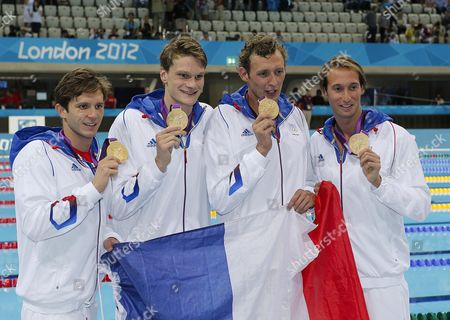 (l-r) Clement Lefert Yannick Agnel Amaury Leveaux and Fabien Gilot of France Pose with a French Flag and Their Gold Medals After Winning the Men's 4x100m Freestyle Relay Final During the Swimming Competition Held at the Aquatics Center During the London 2012 Olympic Games in London England 29 July 2012 United Kingdom London