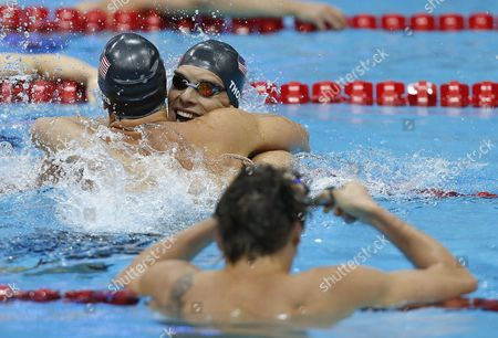 Winner Matthew Grevers (l) of the United States of America (usa) and His Teammate Second Placed Nick Thoman (c) Celebrate After Competing in the Men's 100m Backstroke Final While 4th Placed Camille Lacourt (front) of France is Disappointed During the Swimming Competition Held at the Aquatics Center During the London 2012 Olympic Games in London England 30 July 2012 United Kingdom London