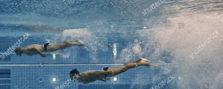 Thomas Daley (bottom) and Peter Waterfield of Great Britain Compete in the Men's Synchronised 10m Platform Diving Final at the Aquatics Center During the London 2012 Olympic Games in London England 30 July 2012 United Kingdom London