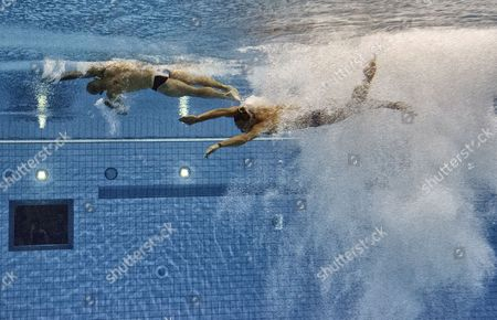 Thomas Daley (l) and Peter Waterfield of Great Britain Compete in the Men's Synchronised 10m Platform Diving Final at the Aquatics Center During the London 2012 Olympic Games in London England 30 July 2012 United Kingdom London