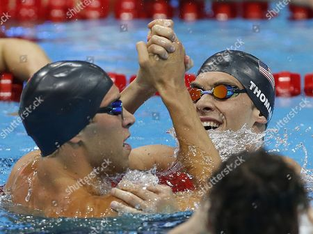 Winner Matthew Grevers (l) of the United States of America (usa) and His Teammate Second Placed Nick Thoman (r) Celebrate After Competing in the Men's 100m Backstroke Final While 4th Placed Camille Lacourt (front) of France is Disappointed During the Swimming Competition Held at the Aquatics Center During the London 2012 Olympic Games in London England 30 July 2012 United Kingdom London