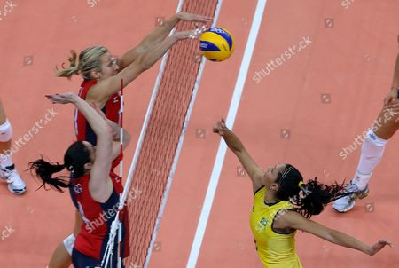 Usa's Megan Hodge (c) Slams the Ball Against Brazil's Sheilla Castro (r) As Her Team Mate Lindsey Berg (l)asists During Their Women's Preliminary Round Match at the London 2012 Olympic Games Volleyball Competition London Britain 30 July 2012 United Kingdom London