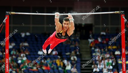 Germany's Philipp Boy Slips Off the Bar As He Competes in the Qualification Round on the Horizontal Bar During the London 2012 Olympic Games Artistic Gymnastics Competition London Britain 28 July 2012 United Kingdom London