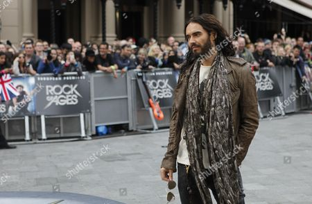 Russel Brand Poses For Photographers As He Arrives For the European Premier of Rock of Ages at the Odeon Theatre in London Britain 10 June 2012 United Kingdom London