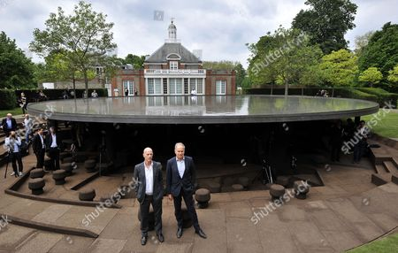 Swiss Architects Jacques Herzog (l) and Pierre De Meuron (r) Pose at the 2012 Serpentine Gallery Pavilion in London Britain 31 May 2012 the Serpentine Gallery Pavilion Designed by Herzog and De Meuron and Chinese Artist Ai Weiwei is the Twelfth Commission in the Gallery Annual Series the 2012 Pavilion Takes Visitors Beneath a Roof of Water Below the Serpentine's Lawn to Explore the Hidden History of Its Previous Pavilions Ai Weiwei was not Present Because He is Forbidden to Leave China United Kingdom London