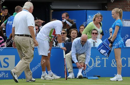 Line Judge Andrew Mcdougall (centre R) is Consolded by Argentina's David Nalbandian (l) After Nalbandian Kicked Boarding Into Mcdougall's Shin During the Aegon Tennis Championship Final in London Britain 17 June 2012 Marin Cilic Won by Default 6-7 4-3 After Nalbandian Had Injured the Line Judge United Kingdom London