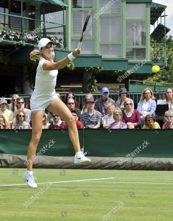 Anna Tatishvili of Georgia Returns to Tamarine Tanasugarn of Thailand During Their First Round Match For the Wimbledon Championships at the All England Lawn Tennis Club in London Britain 25 June 2012 United Kingdom Wimbledon