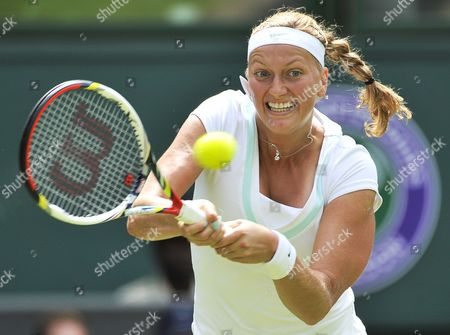 Petra Kvitova of the Czech Republic Returns to Akgul Amanmuradova of Uzbekistan During Their First Round Match For the Wimbledon Championships at the All England Lawn Tennis Club in London Britain 26 June 2012 United Kingdom Wimbledon