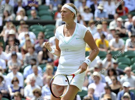 Stock Photo of Petra Kvitova of the Czech Republic Celebrates a Winner Against Akgul Amanmuradova of Uzbekistan During Their First Round Match For the Wimbledon Championships at the All England Lawn Tennis Club in London Britain 26 June 2012 United Kingdom Wimbledon