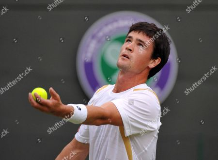 Jamie Baker of Britain Serves to Andy Roddick of the Us During Their First Round Match For the Wimbledon Championships at the All England Lawn Tennis Club in London Britain 27 June 2012 United Kingdom Wimbledon