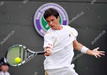 Jamie Baker of Britain Returns to Andy Roddick of the Us During Their First Round Match For the Wimbledon Championships at the All England Lawn Tennis Club in London Britain 27 June 2012 United Kingdom Wimbledon
