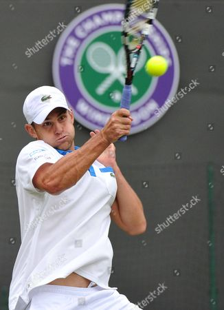 Andy Roddick of the Us Returns to Jamie Baker of Britain During Their First Round Match For the Wimbledon Championships at the All England Lawn Tennis Club in London Britain 27 June 2012 United Kingdom Wimbledon
