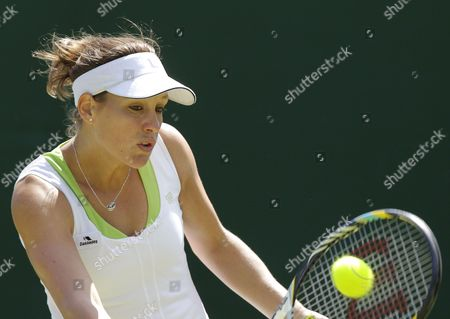 Stock Picture of Stephanie Dubois of Canada Returns to Jie Zheng of China During Their First Round Match For the Wimbledon Championships at the All England Lawn Tennis Club in London Britain 26 June 2012 United Kingdom Wimbledon