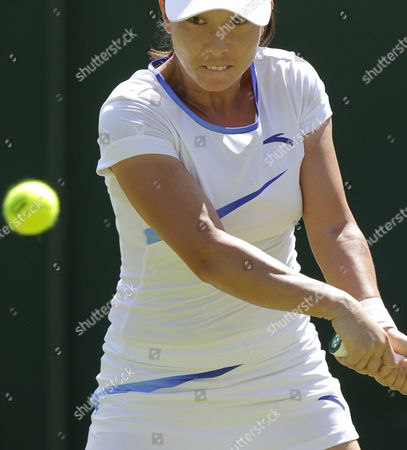 Jie Zheng of China Returns to Stephanie Dubois of Canada During Their First Round Match For the Wimbledon Championships at the All England Lawn Tennis Club in London Britain 26 June 2012 United Kingdom Wimbledon