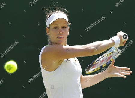 Stock Photo of Stephanie Dubois of Canada Returns to Jie Zheng of China During Their First Round Match For the Wimbledon Championships at the All England Lawn Tennis Club in London Britain 26 June 2012 United Kingdom Wimbledon
