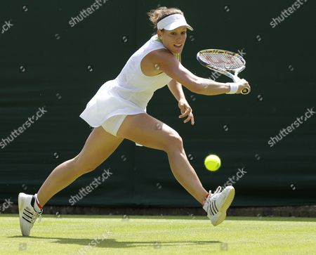 Stephanie Dubois of Canada Returns to Jie Zheng of China During Their First Round Match For the Wimbledon Championships at the All England Lawn Tennis Club in London Britain 26 June 2012 United Kingdom Wimbledon