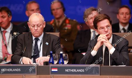 Netherlands Prime Minister Mark Rutte (r) and Minister of Foreign Affairs Uri Rosenthal (l) Listen to Speeches During the North Atlantic Council Meeting During the Nato 2012 Summit at the Mccormick Place in Chicago Illinois Usa 20 May 2012 United States Chicago