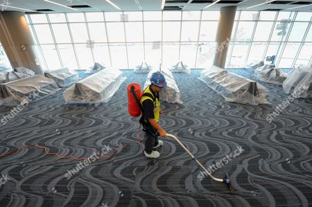 Israel Estrada Vacuums the Carpet in Concourse F of the New Maynard H Jackson Jr International Terminal is Seen at Hartsfield-jackson Atlanta International Airport in Atlanta Georgia Usa on 22 March 2012 the 1 2 Million-square-foot Terminal is Scheduled to Open 16 May 2012 the Facility Connects with the Existing International Concourse Creating a 40-gate Complex the International Terminal Will Eliminate the Need For Atlanta-bound Passengers to Recheck Their Baggage United States Atlanta
