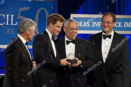 Britain's Prince Harry (c-l) Receives the Distinguished Humanitarian Leadership Award From Former Secretary of State Colin Powell (c-r) While Atlantic Council President Fred Kempe (r) and Former Senator From Nebraska Chuck Hagel (l) Look on at the Atlantic Council's Annual Awards Dinner at the Ritz Carlton in Washington Dc Usa 07 May 2012 Un Secretary General Ban Ki-moon and Violinist Anne-sophie Mutter Were Also Honored at the Event United States Washington