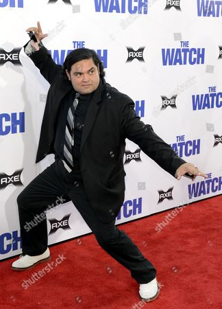 Stock Photo of Us Musician Joe Nunez Strikes a Pose As He Arrives For the Watch Premiere at the Chinese Grauman's Theatre in Hollywood California Usa 23 July 2012 United States Hollywood