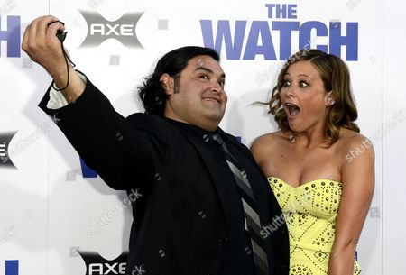 Stock Image of Us Musician Joe Nunez (l) and Us Actress Jennifer Shaffer (r) Pretend to Take Self Portraits As They Arrive For the Watch Premiere at the Chinese Grauman's Theatre in Hollywood California Usa 23 July 2012 United States Hollywood