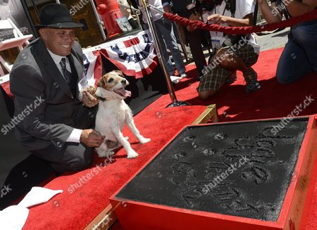 Uggie the Dog (r) and His Owner/trainer Omar Von Muller (l) Pose Next to Uggie's Paw Prints in Cement During a Ceremony Honoring the Dog's Contribution to Cinema and Marking His Retirement From the Movies at Chinese Grauman's Theatre in Hollywood California Usa 25 June 2012 Uggie was Featured in the Oscar Winning 2011 Best Picture Movie 'The Artist' United States Hollywood