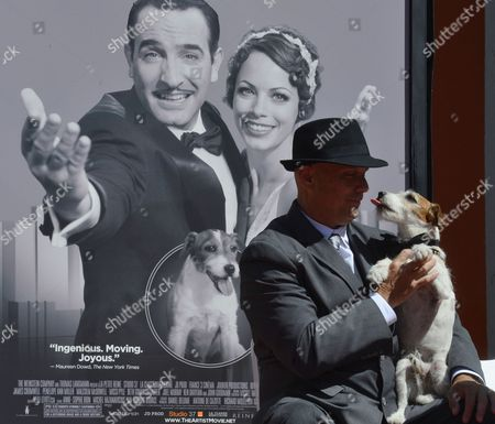 Uggie the Dog (r) Licks His Trainer and Owner Omar Von Muller (l) During a Cement Ceremony Honoring the Dog's Contribution to Cinema and Marking His Retirement From the Movies at Chinese Grauman's Theatre in Hollywood California Usa 25 June 2012 Uggie was Featured in the Oscar Winning 2011 Best Picture Movie 'The Artist' United States Hollywood