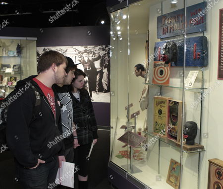 Jake King (l) Matt Barrett (c) and Megan Shire (r) Look at Racist Memorabilia Caricaturing Black People on Display at the Jim Crow Museum of Racist Memorabilia Located at Ferris State University in Big Rapids Michigan Usa on 27 April 2012 the Museum's Goal is to Use Objects of Intolerance to Teach Tolerance and Promote Social Justice From the Museum the Original Jim Crow Came About in the 1830s and '40s the White Entertainer Thomas Dartmouth Rice Performed a Popular Song-and-dance Act Supposedly Modeled After a Slave He Named the Character Jim Crow After the American Civil War (1861-1865) Most Southern States and Later Border States Passed Laws That Denied Blacks Basic Human Rights It is not Clear How But the Minstrel Character's Name 'Jim Crow' Became a Kind of Shorthand For the Laws Customs and Etiquette That Segregated and Demeaned African Americans Primarily From the 1870s to the 1960s United States Big Rapids
