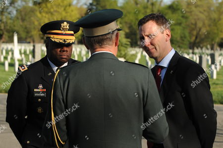 Danish Minister of Defense Nick Haekkerup (r) Speaks with Danish Brigadier General Joergen Jacobson (c) and Us Lieutenant Colonel Keaven Stevenson (l) During a Visit to the Arlington National Cemetery in Arlington Virginia Usa 26 March 2012 Defense Minister Haekkerup Placed a Wreath at the Memorial to Us Airmen Killed Over Denmark United States Arlington
