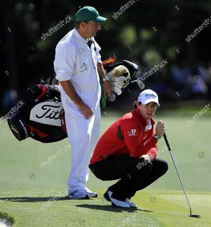 Rory Mcilroy of Northern Ireland (r) and His Caddie J P Fitzgerald (l) on the Eighteenth Hole During the Second Round of the 2012 Masters Tournament at the Augusta National Golf Club in Augusta Georgia Usa 06 April 2012 the Masters Will Be Played 05 April Through 08 April 2012 United States Augusta