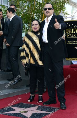 Mexican Musician Pepe Aguilar (r) Gives the Thumbs Up As He Embraces His Mother Flor Silvestre (l) During a Ceremony Honoring Him with a Star on the Hollywood Walk of Fame in Hollywood California Usa 26 July 2012 Aguilar Considered by Critics As a 'Latin Music Superstar' is a Multiply Grammy and Latin Grammy Winner and His Recordings Have Sold Over 12 Million Copies United States Hollywood