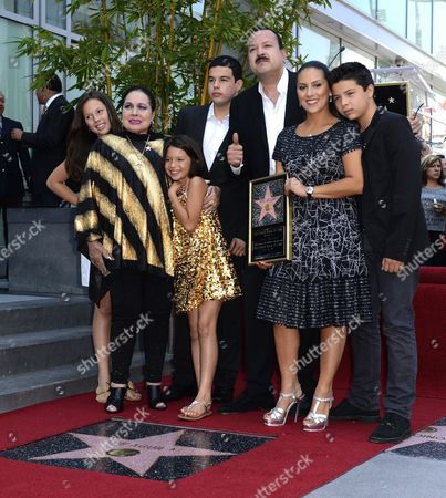 Stock Photo of Mexican Musician Pepe Aguilar (3-r) Poses with His Family Including His Mother Flor Silvestre (2-l) As He is Honored with a Star on the Hollywood Walk of Fame in Hollywood California Usa 26 July 2012 Aguilar Considered by Critics As a 'Latin Music Superstar' is a Multiply Grammy and Latin Grammy Winner and His Recordings Have Sold Over 12 Million Copies United States Hollywood