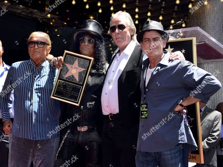 Stock Photo of Us Musician Slash (2l) Poses with Speakers Us Film Producer Robert Evans (l) Us Radio Personality Jim Ladd (2r) and Us Actor Charlie Sheen (r) During Slash's Star Ceremony on the Hollywood Walk of Fame in Hollywood California Usa 10 July 2012 Slash was Awarded the 2 473rd Star on the Hollywood Walk of Fame in the Recording Category United States Hollywood