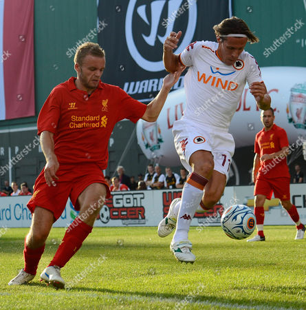 Roma's Rodrigo Taddei (r) Battles with Liverpool's Martin Skrtel (r) During the First Half at Fenway Park in Boston Massachusetts Usa 25 July 2012 United States Boston