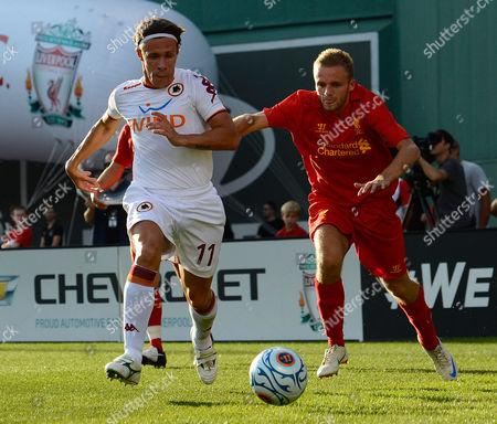 Roma's Rodrigo Taddei (l) Battles with Liverpool's Martin Skrtel (r) During the First Half at Fenway Park in Boston Massachusetts Usa 25 July 2012 United States Boston