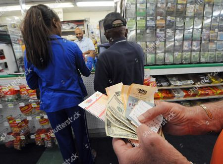 Stock Picture of Joe Bruno of Pelham Alabama Waits to Purchase Lottery Tickets at Robinson's Convenience Store For the Multi-state Mega Millions Game Which Has an Estimated Jackpot of $540 Million to a Single Winner in Tallapoosa Georgia Usa Near the Alabama State Line on 29 March 2012 Alabama Does not Participate in the Mega Millions Lottery the 30 March 2012 Drawing is Now the Largest Lottery Jackpot in World History United States Tallapoosa