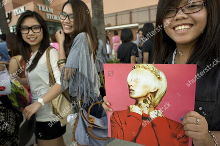 Stock Image of A Fan of Korean Pop Rock Holds a Picture of Lee Hyuk-jae of the Group Super Junior Before a Concert at the Honda Center in Anaheim California Usa 20 May 2012 the Concert Called Sm Town Live World Tour Iii was a Compilation of Numerous Groups Owned and Managed by S M Entertainment the Performance in Anaheim was the Opening of the World Tour United States Anaheim