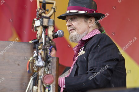 Stock Image of New Orleans Musician Malcolm John 'Mac' Rebennack Jr Better Known by the Stage Name Dr John Performs with Voice of the Wetlands All-stars Band on the Acura Stage at the New Orleans Jazz and Heritage Festival at the New Orleans Fair Grounds Race Course in New Orleans Louisiana Usa 28 April 2012 the New Orleans Jazz and Heritage Festival Celebrates It's 43rd Anniversary This Year with 12 Different Stages in an Annual 10-day Cultural Celebration That Encompasses Every Style of Music Associated with the City of New Orleans That Includes Jazz Gospel Cajun Zydeco Blues Rhythm and Blues Rock Funk African Latin Caribbean Folk and Much More in Addition to Local Cuisine Culture Arts and Crafts United States New Orleans