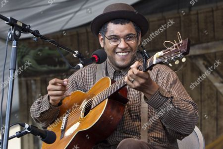 American Old-time String Band Guitarist Dom Flemons of the Carolina Chocolate Drops Performs on the Fais Do-do Stage at the New Orleans Jazz and Heritage Festival at the New Orleans Fair Grounds Race Course in New Orleans Louisiana Usa 28 April 2012 the New Orleans Jazz and Heritage Festival Celebrates It's 43rd Anniversary This Year with 12 Different Stages in an Annual 10-day Cultural Celebration That Encompasses Every Style of Music Associated with the City of New Orleans That Includes Jazz Gospel Cajun Zydeco Blues Rhythm and Blues Rock Funk African Latin Caribbean Folk and Much More in Addition to Local Cuisine Culture Arts and Crafts United States New Orleans