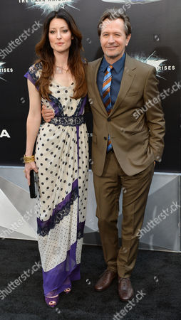 Actor Gary Oldman (r) and Alexandra Edenborough (l) Arrive For the World Premiere of 'The Dark Knight Rises' in New York New York Usa 16 July 2012 the Movie Which is the Third in the Dark Knight Trilogy Opens Nationwide on 20 July 2012 United States New York