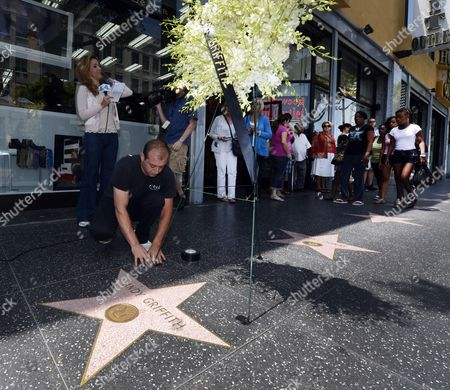 A Man Places a Wreath of Flowers From the Hollywood Chamber of Commerce Next to the Star of Us Actor Andy Griffith on the Hollywood Walk of Fame in Hollywood California Usa 03 July 2012 the Popular Actor Known For His Role As Sheriff Andy Taylor in the Andy Griffith Show Died Today at the Age of 86 at His North Carolina Home United States Hollywood