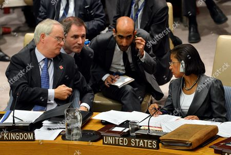 Stock Photo of Susan Rice (r) United States' Ambassador to the United Nations and Sir Mark Lyall Grant (l) the United Kingdom's Ambassador to the United Nations and Staff Confer During a United Nations Security Council Meeting on the Ongoing Violence in Syria at the United Nations Headquarters in New York City New York Usa 19 July 2012 Russia and China Vetoed a Draft Western Un Security Council Resolution Requesting a New Mandate For Unarmed Military Observers in Syria United States New York