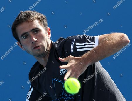 Marsel Ilhan of Turkey Returns a Shot Against Sebastien Grosjean of France During Their First Round Match at the Australian Open Tennis Tournament in Melbourne 18 January 2010 Epa/francis R Malasig Australia Melbourne