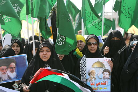 Bahraini Women March on the Outskirts of the Capital Manama During the Annual International Quds (jerusalem) Day on 05 October 2007 Thousands of Bahrainis Mainly Shiites Took to the Streets Answering the Annual Call by the Late Founder of the Iranian Islamic Republic Grand Ayatollah Seyyed Ruhollah Musavi Khomeini Demonstrators Marched Through Mainly Shiite Villages Chanting Death to America Death to Israel and Israel Must Be Wiped Off the Map Hundreds of Women in Black Chador Also Took Part in the March where Larger Posters of Ayatollah Khomeini Were Raised Alongside Pictures of Irans Present Supreme Leader Seyyed Ali Khamenei and the General Secretary of the Lebanese Hezbollah Seyyed Hassan Nasrallah Bahrain Manama
