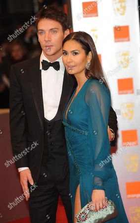 Irish Actor Jonathan-rhys Meyers (l) and Reena Hammer (r) Arrive For the British Academy of Film and Television Arts (bafta) Awards Ceremony at the Royal Opera House in London Britain 21 February 2010 the Bafta Awards Honor Achievement Within the Film and Television Industry in 23 Categories United Kingdom London